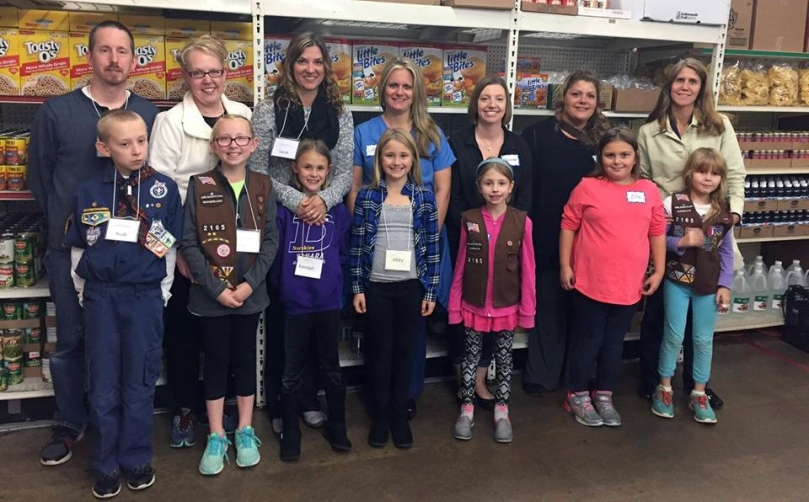 Brownie Girl Scouts volunteering at the River Food Pantry.